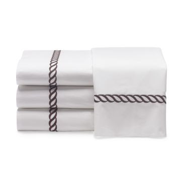 White bedding with a brown rope twist pattern from William Sonoma Home