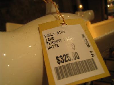 Price tag on a white ceramic bird pendant light from ABC Carpet & Home