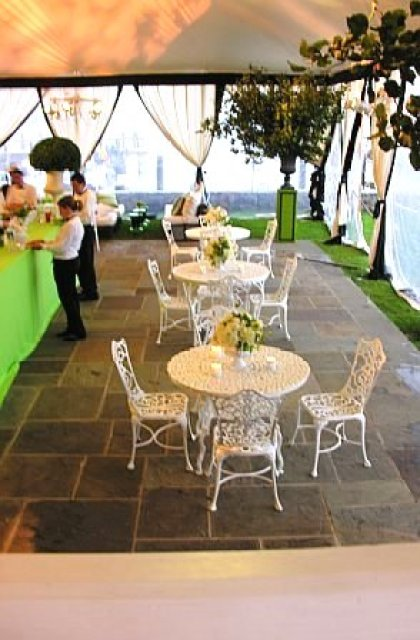 White metal table and outdoor chairs at a wedding by Delaney Todd Bagwell
