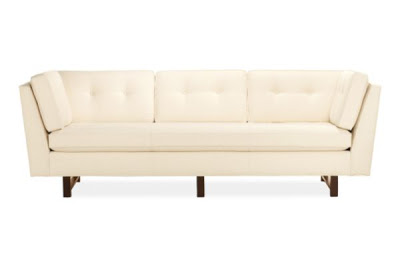 Cream sofa with Ebony stained legs, angled high arms and button tufted back pillow from Room & Board