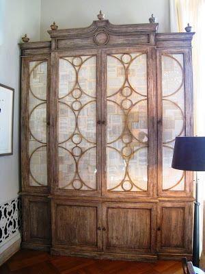 Large stained wood cabinet with white linen fronts with wood circle detailing in the Grand Salon Ballroom at the Greystone Mansion