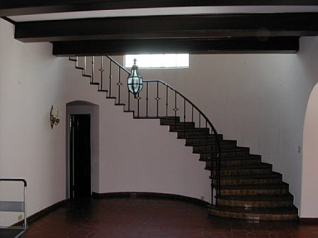 Dark and dingy foyer before remodeling