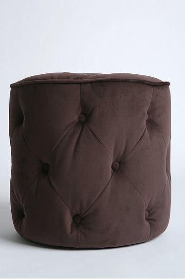 Brown tufted velvet round ottoman from Urban Outfitters