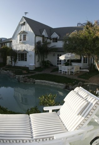 Exterior of a beach house backyard with a pool