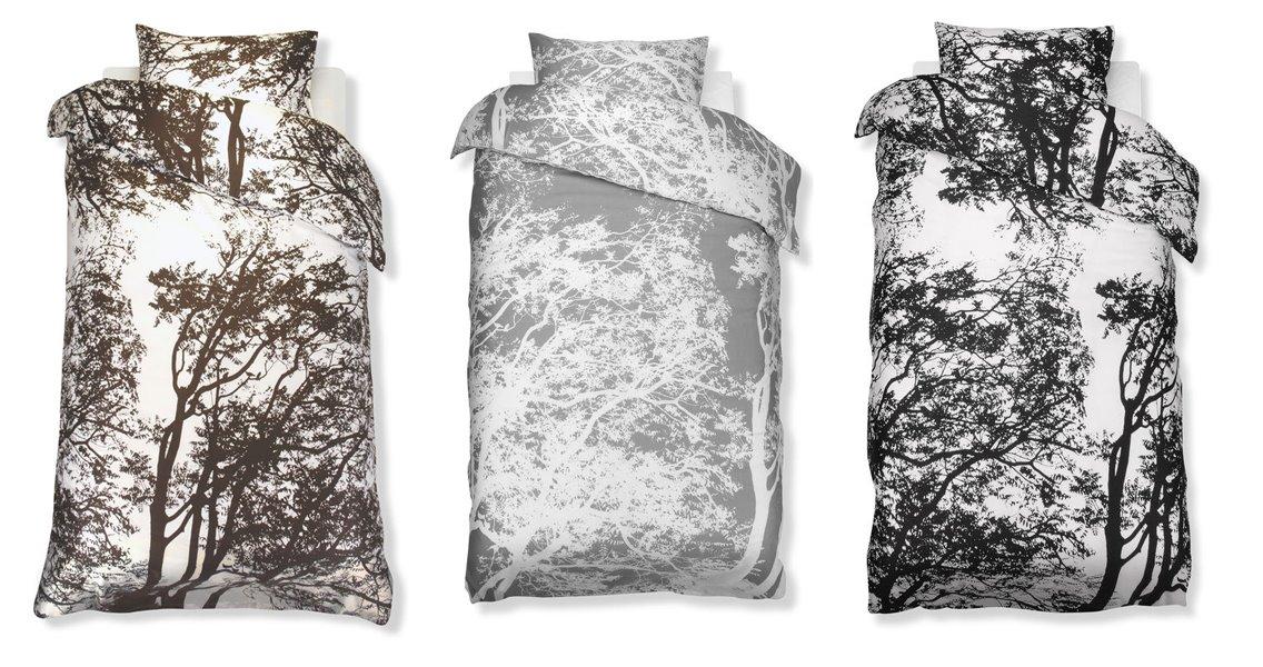 three patterned duvet covers from marimekko with graphic tree paterns by maija and kristina isola