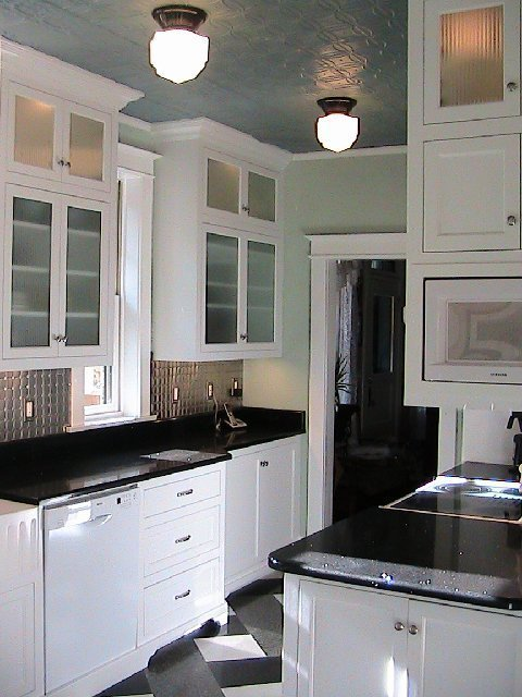 Kitchen After Remodeling With Plaid Floor, White Lower Cabinets With  Recessed Panels And Glass Upper