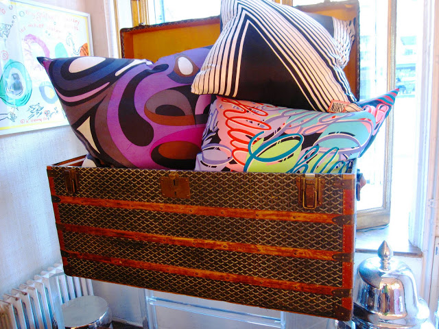 Vintage Goyard trunk filled with designer pillows inside the Elizabeth Bauer store