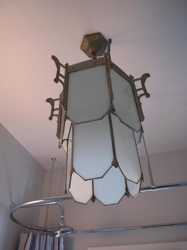 Art deco chandelier in a bathroom by Newman & Wolen Design