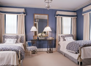 Symmetricla blue bedroom with two twin beds by Kelley Proxmire