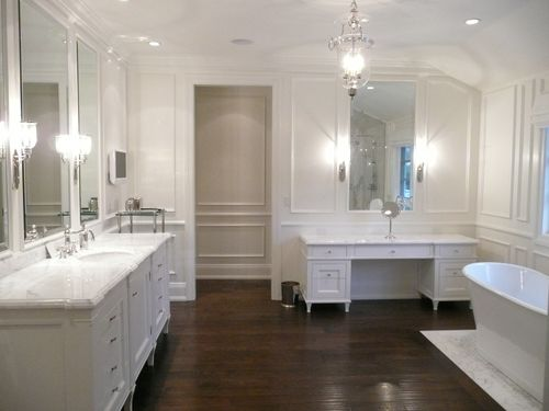 Traditional white bathroom with decorative molding