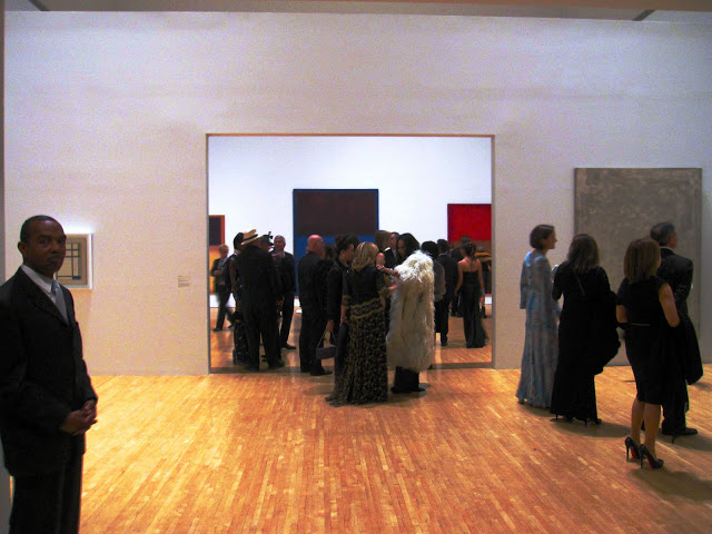 People mingling in the permanent collection at MOCA's 30th anniversary party