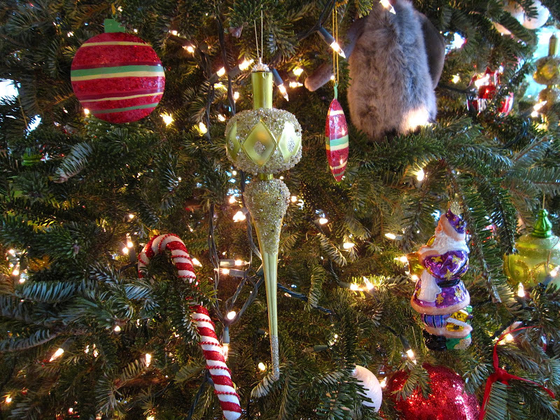 Close up of ornaments on a Christmas tree in the Garden Room of a historic New Orleans mansion