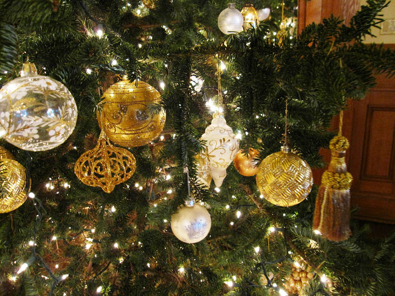 Close up of ornaments on a formal Christmas tree in the Front Hall of a historic New Orleans mansion