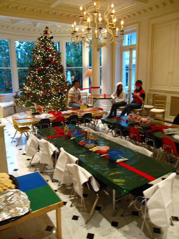 Garden Room of a historic New Orleans mansion with a large Christmas tree ready for children's party