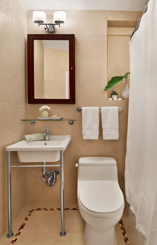 Small New York City bathroom with beige floor and ceiling tiles and white fixtures and towels