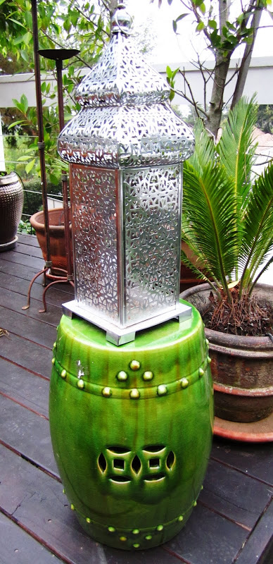 Silver Moroccan lantern and a green ceramic Chinese garden stool
