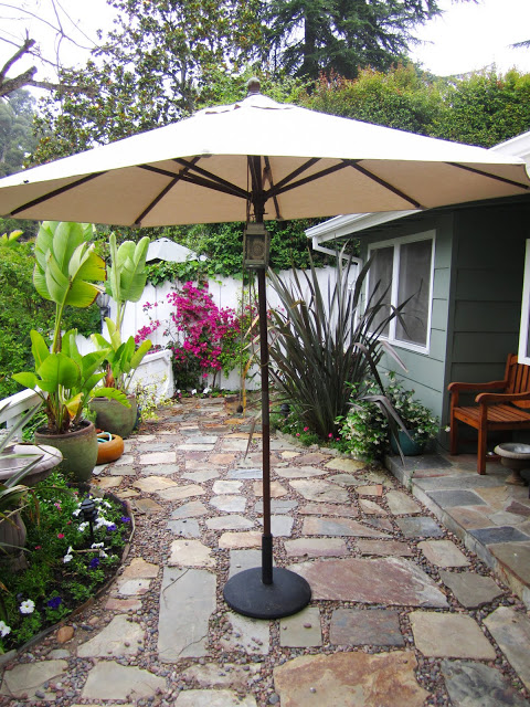 Sand color 9' market umbrella and metal umbrella stand