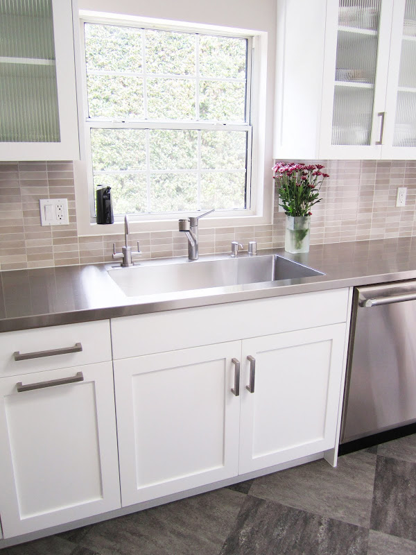 Kitchen with huge stainless steel sink fully integrated into the stainless counter