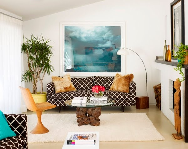 Living room with sofa upholstered in Lulu DK's Chant fabric in chocolate brown, a white shag rug and Arco light