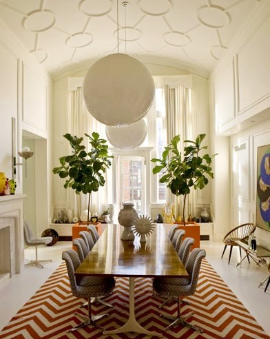 Jonathan Adler's NYC dining room with vintage George Nelson table, an orange and white chevron patterned rug and an arched ceiling with graphic decorative molding