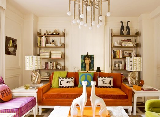 Jonathan Adler's NYC home with Jonathan Adler designed Meurice Chandelier, burnt orange sofa and pink armchair