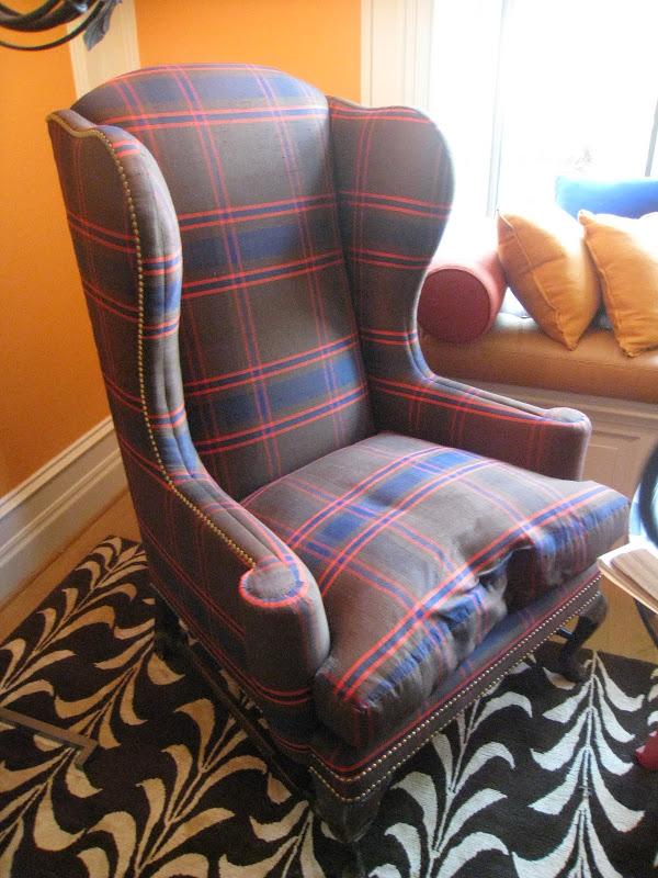 Plaid wingback armchair with nail head trim