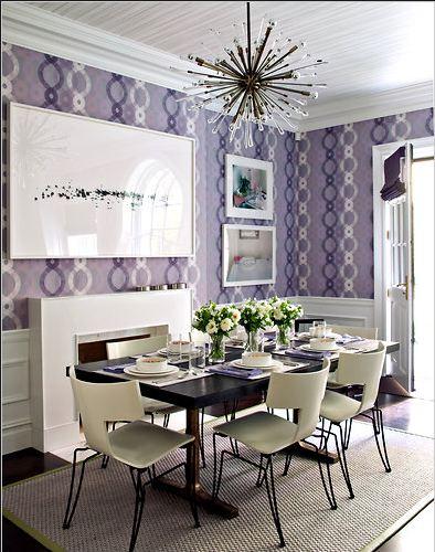 Dining room with lavender wallpaper, white fireplace, wood floor, sisal rug and Sputnik chandelier