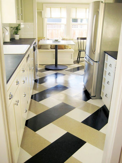 "Kitchen inspired by Tom Newman's. The cabinets are painted Benjamin Moore ""Old Prairie"", the counters are Paperstone in ""Obsidian"" and the floor is made of a vinyl compositio tile"