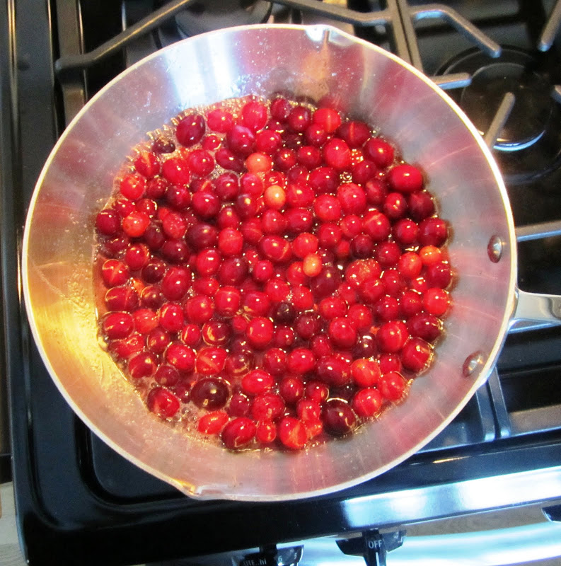 cranberries being cooked to make cranberry sauce