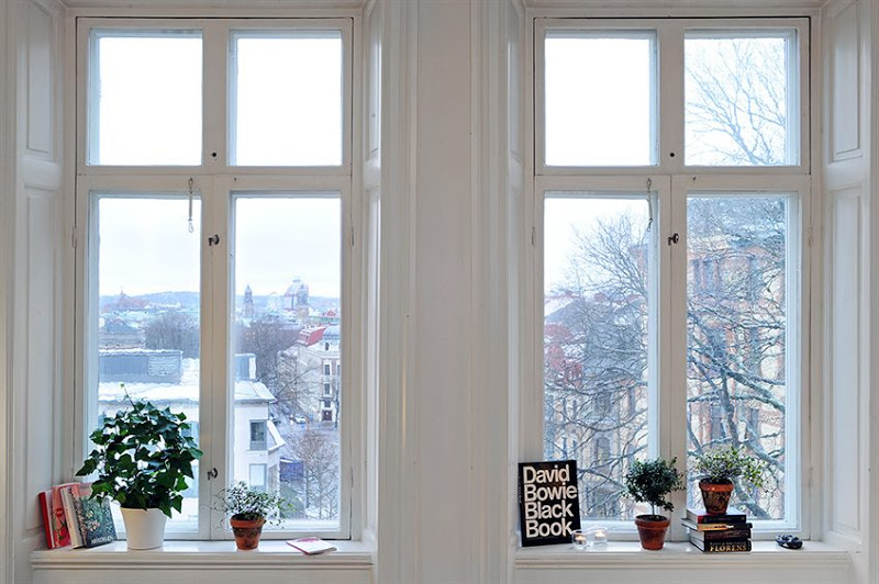 White windows with a view in a Swedish apartment