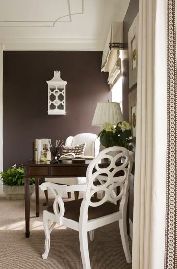 Sitting room with painted ceiling, grey carpet, brown walls, white armchair, white Frances Elkin lacquer chair and white curtains with brown and white embroidered trim