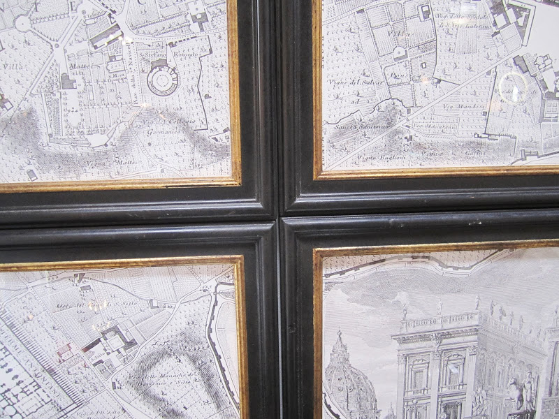 Close up of the intersecting corners of a cut up and framed map