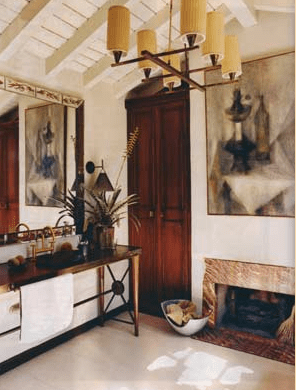 Bathroom with exposed beams, a chandelier, small fireplace, a console sink, large mirror and large piece of art
