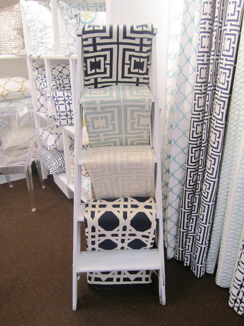 COCOCOZY throws arranged on a ladder at the New York International Gift Fair