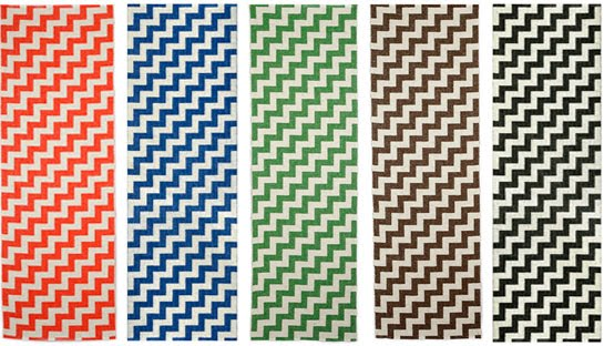 Plastic, washable rugs from Brita Sweden in orange, blue, green, brown and black chevron