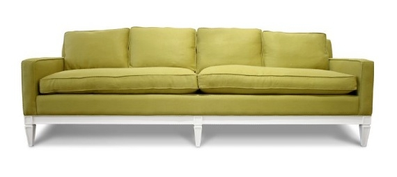 Green sofa with white exposed legs from Jonathan Adler