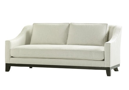 White sofa with exposed maple legs from Baker Furniture