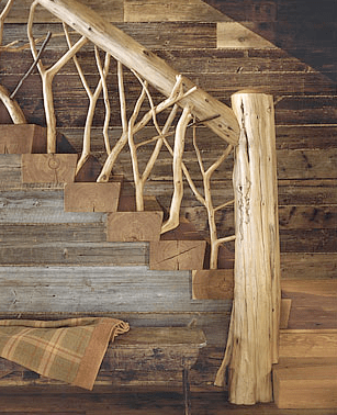 Detail of a main staircase railing made of tree branches and logs by Peter Pennoyer