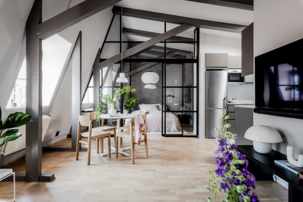 Attic studio home with a glass partition