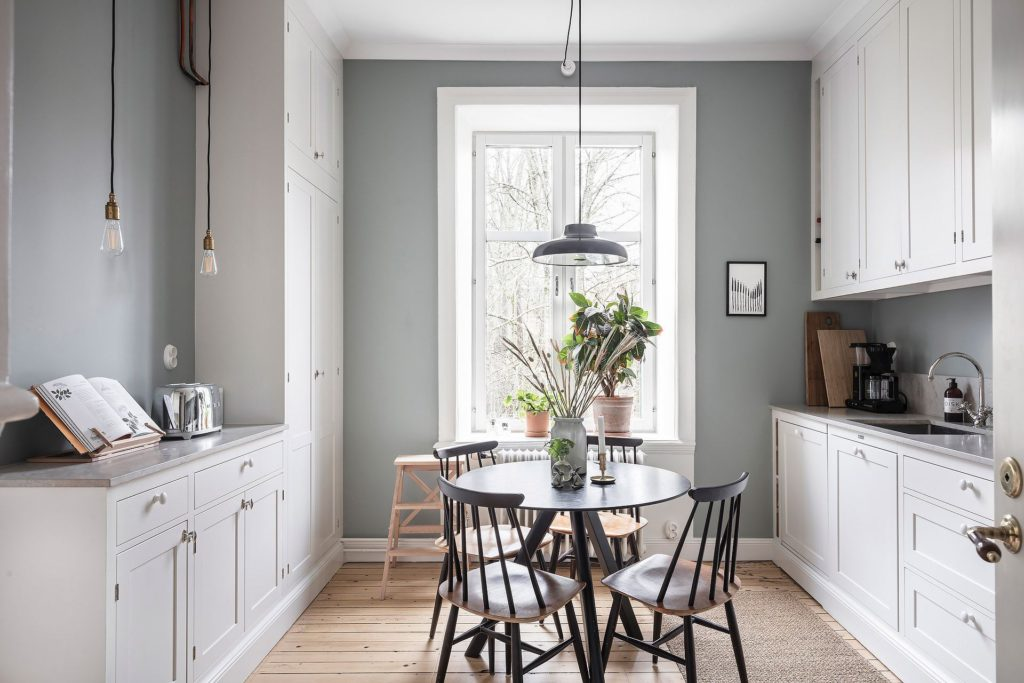 White kitchen with a cozy dining table