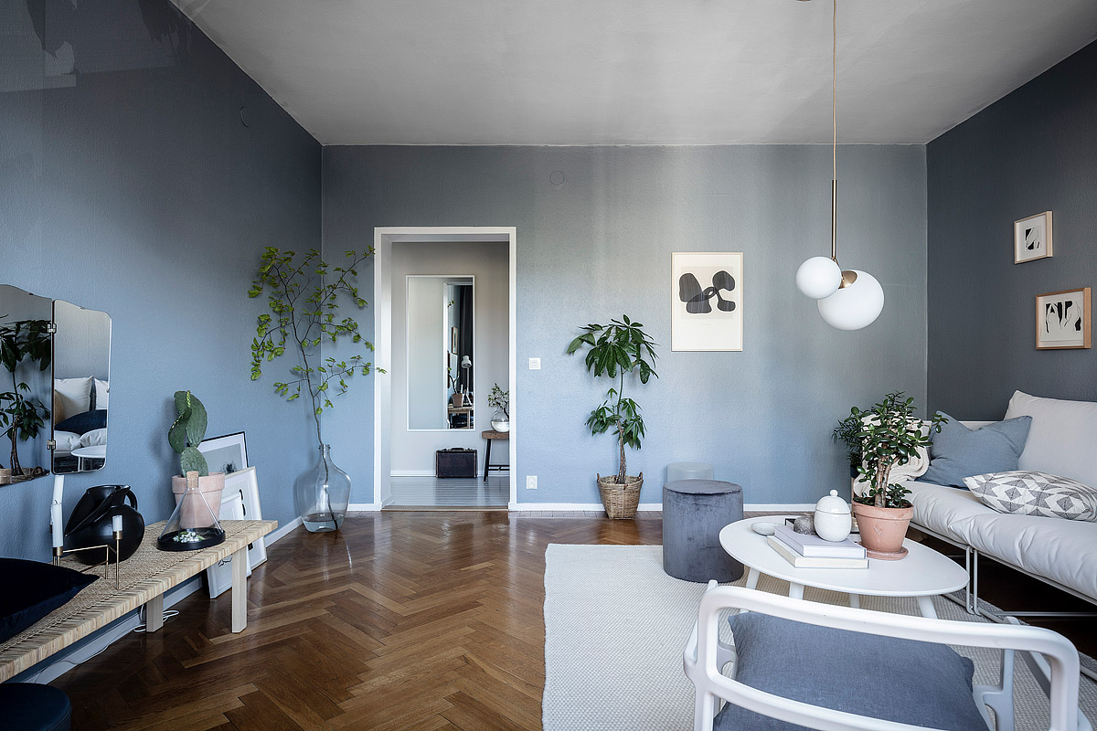 Every single room in this beautiful home has at least one wall that has been painted in a petrol blue or is it more like a grey blue not sure which gives