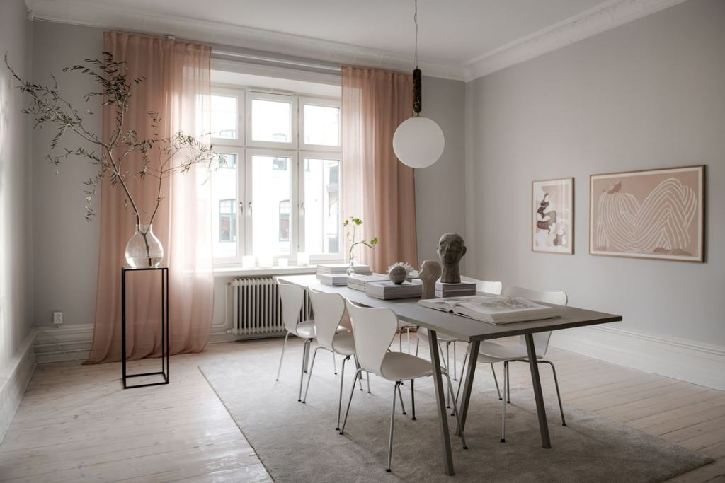 Grey dining room with peach accents