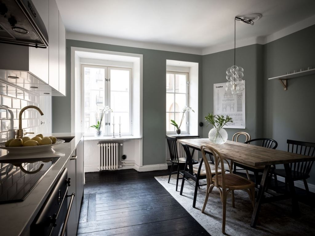 Simple white kitchen combined with a dark wall