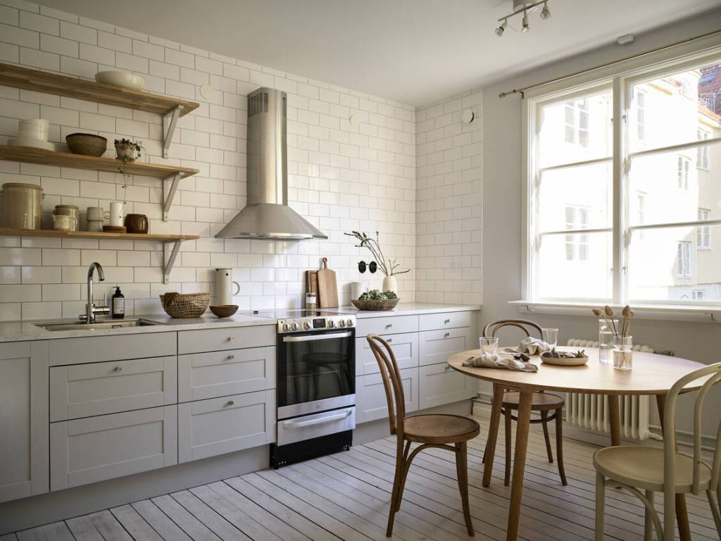 Grey kitchen with round dining table