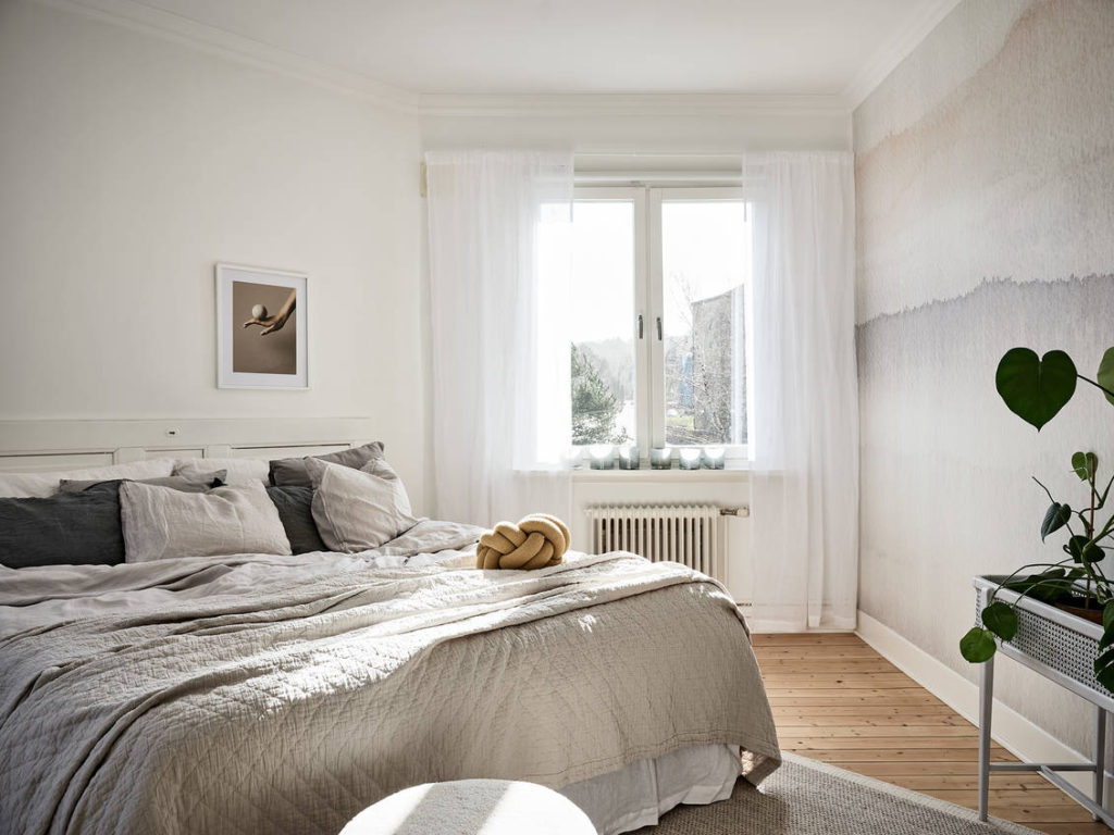Bedroom with a watercolor wall