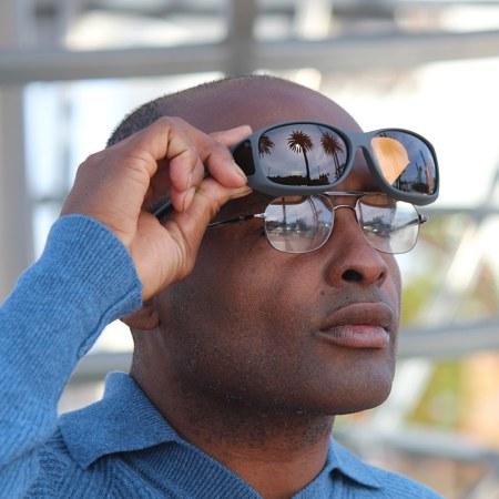 Dude lifting up slate fitover sunglasses