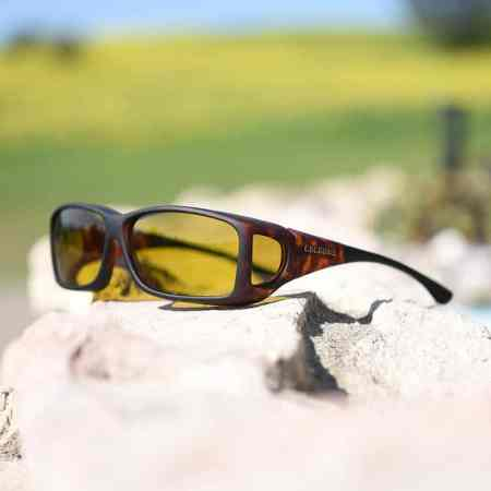 Tortoiseshell fitover sunglasses featuring polarized yellow lenses