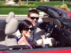 happy couple wearing cocoons fitover sunglasses