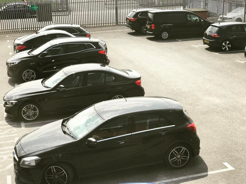 Lots of black vehicles in our car park