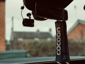 Cocoon Vehicles Face Mask hanging on car mirror